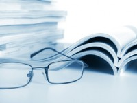 Open journals with glasses